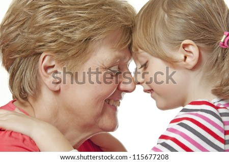 happy grandmother and granddaughter isolated on a white background - stock photo