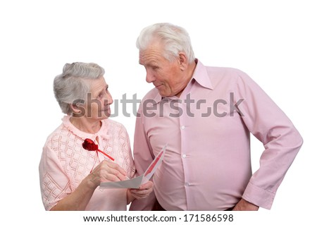 happy grandmother and grandfather with postcard for valentine's day on white background
