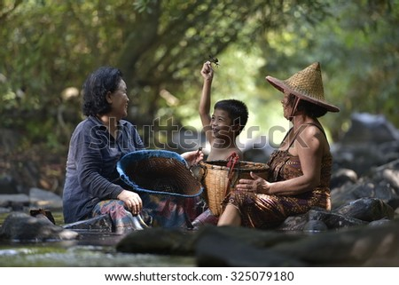 Happy grandmother and grandson are bathing the River  - stock photo