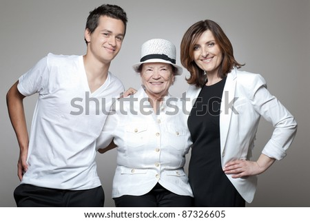 Happy grandmother with adult daughter and grandson.