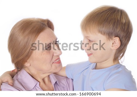 happy grandmother with her grandson on a white background