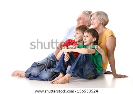 happy grandparents and their two grandchildren in colored T-shirts - stock photo