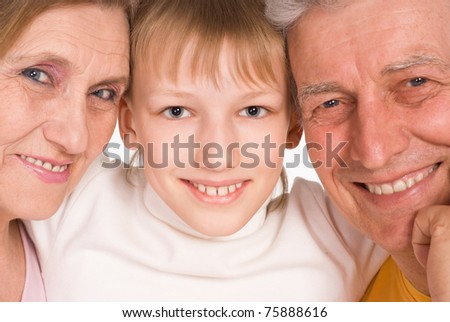 happy grandson with his grandparents on white