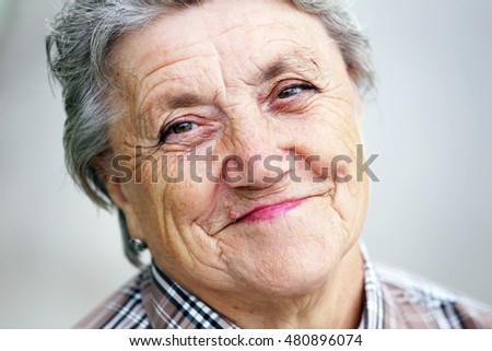 Happy granny face on a gray background