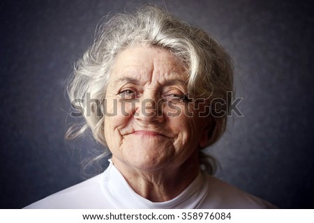 Happy granny portrait on a dark background