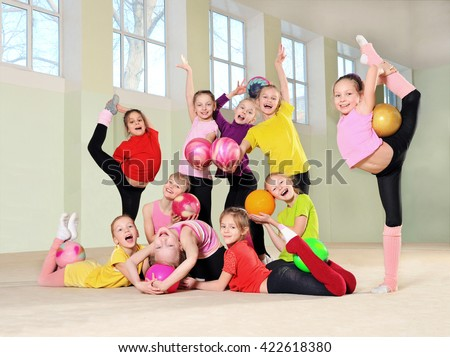 Happy group active children in gym - stock photo