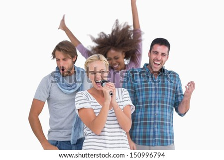 Happy group at karaoke on white background - stock photo