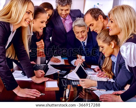 Happy group business people enthusiastically work in office. - stock photo