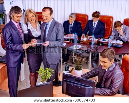 Happy group business people in office.
