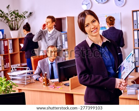 Happy group business people in office. Woman in foreground
