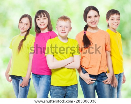 Happy group children at summer. Smiling teen. Frendship boys and girls