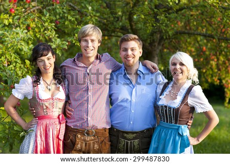 Happy group of bavarian people outdoor