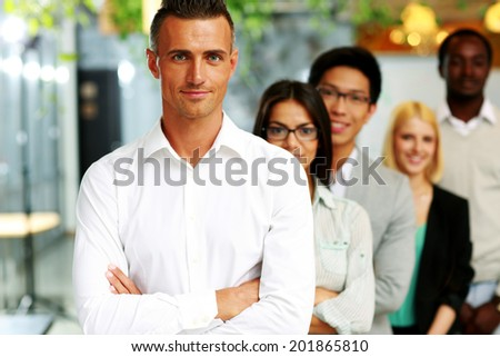 Happy group of business people in the office lined up - stock photo