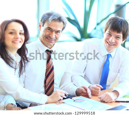 Happy group of business people smiling at the office