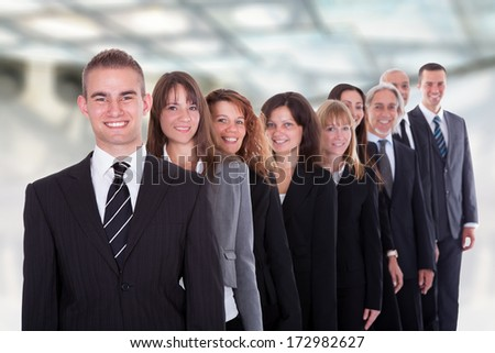Happy Group Of Businesspeople Standing In A Row