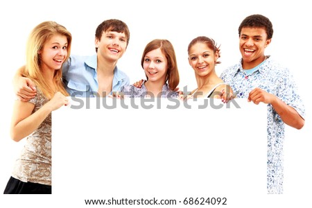 happy group of casual friends holding a banner add isolated on white