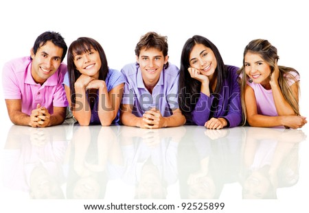 Happy group of casual friends lying on the floor - isolated over a white background