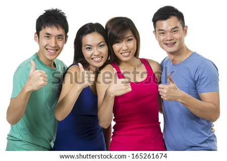 Happy group of Chinese friends celebrating good news. Isolated over white background