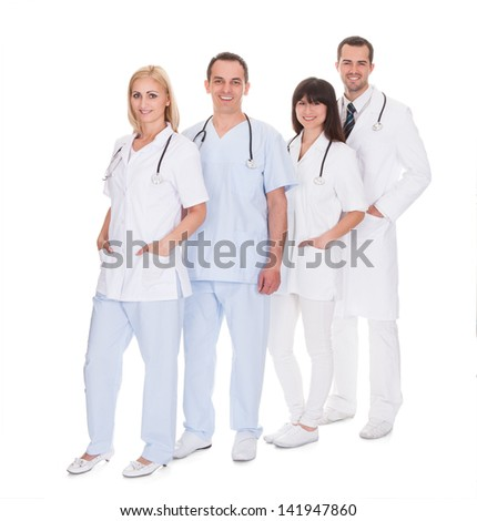 Happy Group Of Doctors Standing Over White Background - stock photo