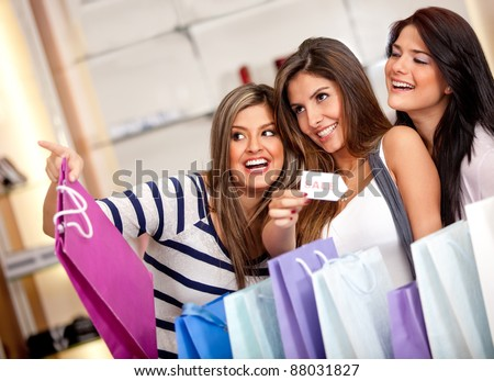 Happy group of females shopping on sale and smiling