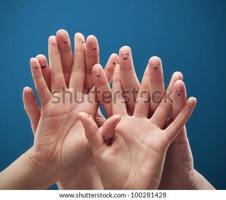 Happy group of finger smileys. Fingers representing a social network. - stock photo