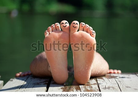 Happy group of finger smileys in nature 2 - stock photo