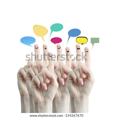 Happy group of finger smileys with social chat sign and speech bubbles. Fingers representing a social network.