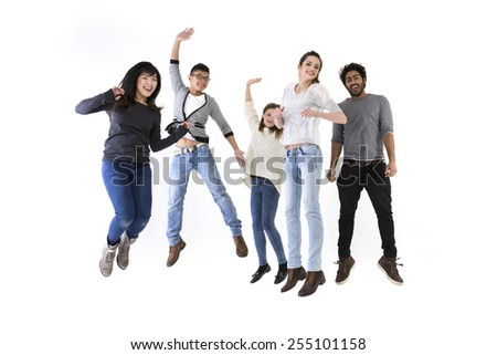 Happy group of five friends jumping. Isolated over white background - stock photo