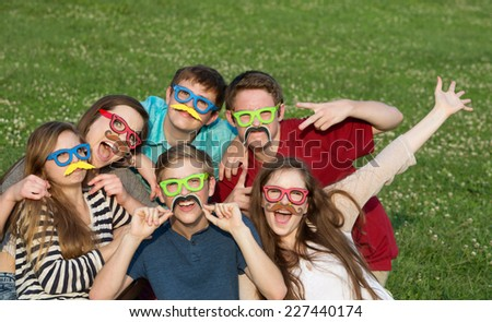 Happy group of five teenagers in silly costume - stock photo