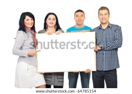 Happy group of four people holding a blank banner and one woman pointing to copy space isolated on white background - stock photo