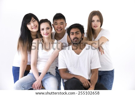 Happy group of friends all wearing white clothing. Mixed race group. Isolated on a white background.