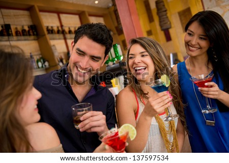 Happy group of friends at the bar having drinks - stock photo