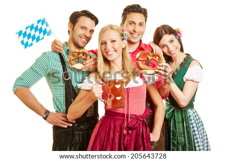 Happy group of friends celebrating Oktoberfest with beer and pretzel - stock photo