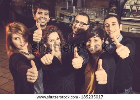Happy Group of Friends in a Night Club