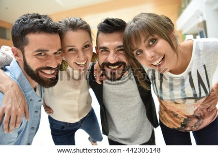 Happy group of friends looking at camera - stock photo