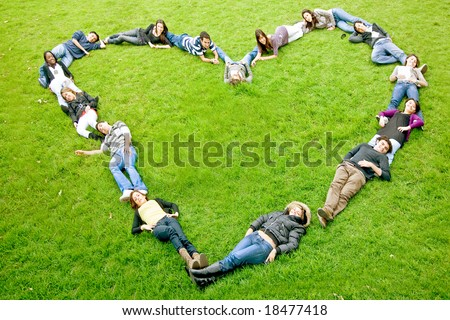 happy group of friends making a heart shape - smiling outdoors in a park - stock photo