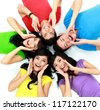 happy group of friends screaming with their heads together on the floor - stock photo