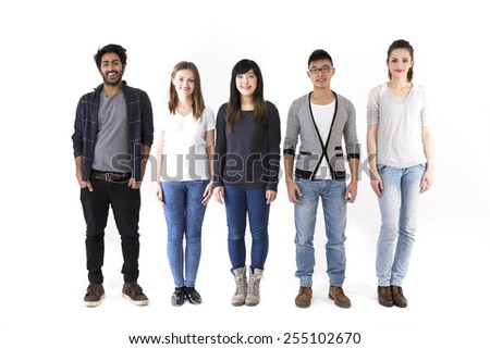 Happy group of friends standing in a row. Mixed race group. Isolated on a white background.