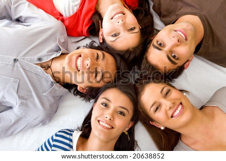 happy group of friends together on the floor