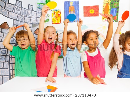Happy group of kids with cardboard shapes