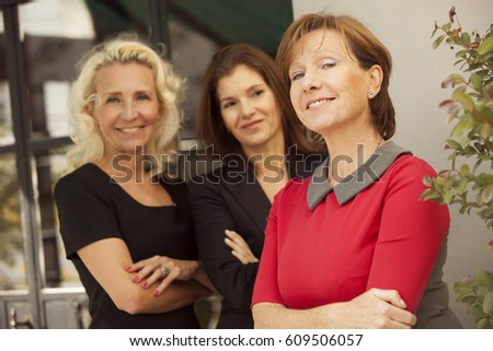 Happy group of mature business women