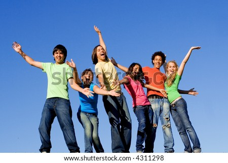 happy group of mixed race teens - stock photo