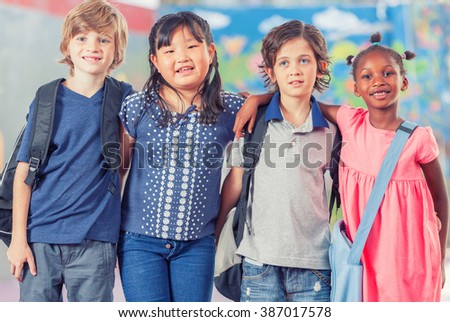 Happy group of multi ethnic children together at school. - stock photo