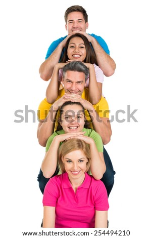 Happy Group Of Multiethnic Friends Stacked In A Row Over White Background - stock photo