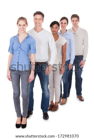 Happy Group Of People Standing In A Row Over White Background - stock photo