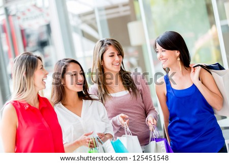 Happy group of shopping girls at the mall - stock photo