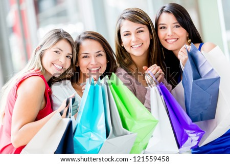 Happy group of shopping women holding bags - stock photo