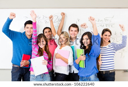 Happy group of students celebrating with arms up - stock photo