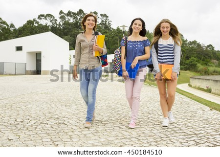 Happy group of students in the school  - stock photo