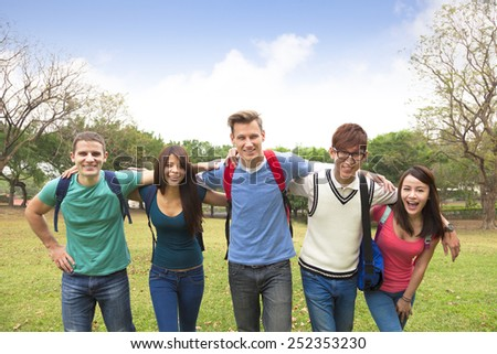 Happy group of students walking together - stock photo